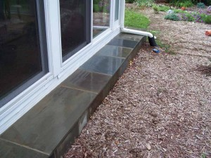 After Repair - Pay special attention to how the edge (corner) is finished by overlapping the horizontal stone over the side (vertical) stone